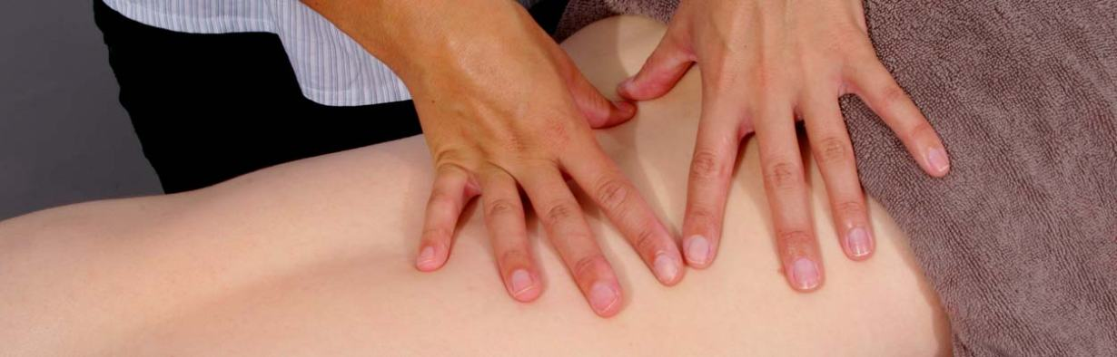 Physiotheraprist Hands on Back